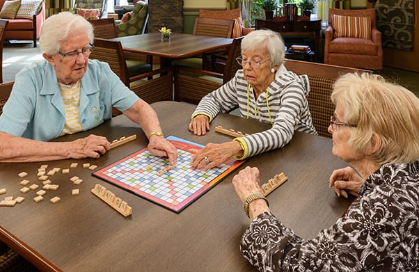 ladies playing a board game