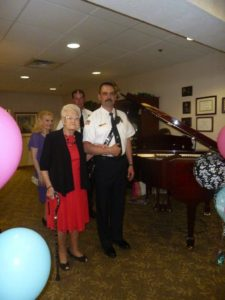 Margaret Burns models a selection from Marshall's while being escorted by Plain Twp Fire Chief Don Snyder.
