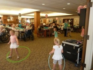 Kids hula-hoop at The Inn at Belden Village family picnic