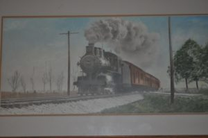 Train photo that hangs above Charley's desk for this months assisted living senior spotlight