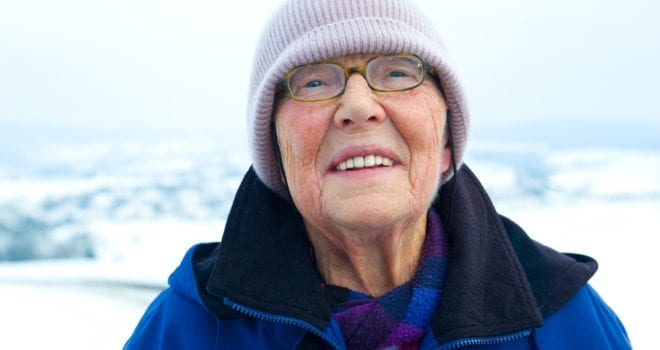Senior citizen bundled for winter weather