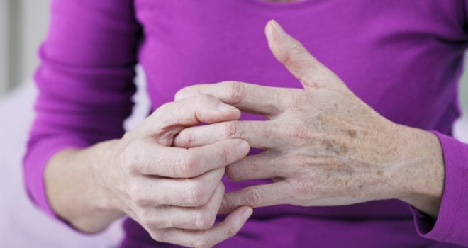 Senior assisted living resident with hurting hands from arthritis