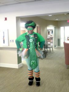 Kiki senior living staff at The Inn at Belden Village wearing her St. Patty's Day Tutu