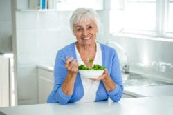 Senior citizen eating a healthy salad