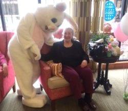 The Inn at Belden Village senior resident with easter bunny