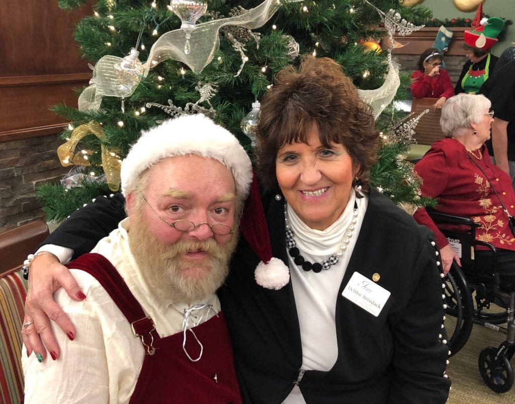 Activities Director Debbie Brindack with Santa